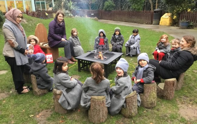 Woodland School lessons around fire pit